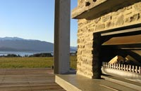 Enjoy a summer evening outside by the fire at Prospect Lodge accommodation Te Anau
